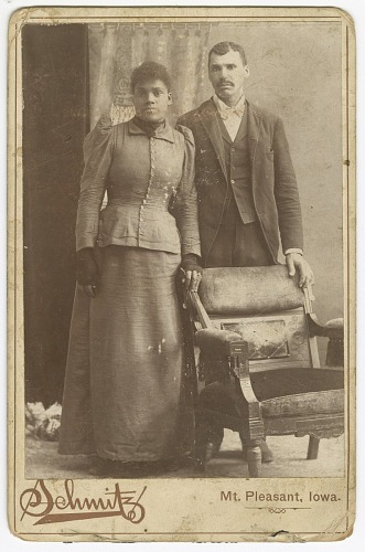 Image for Photograph of a couple standing behind a chair