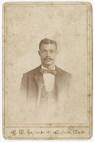 Image for Photograph of a man in a suit, vest and necktie
