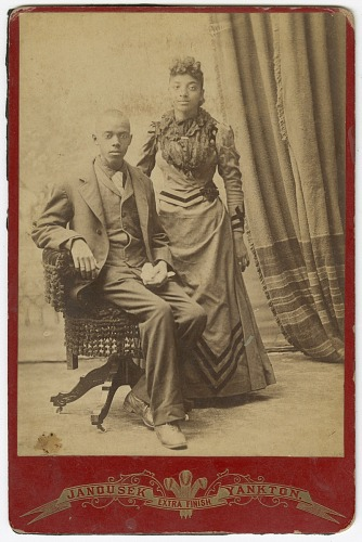 Image for Photograph of a man and woman in formal clothes