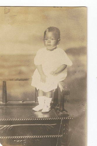 Image for Photographic print of a toddler sitting on a bench