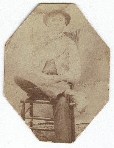 Image for Photographic print of a man in suit sitting on a chair with right leg crossed