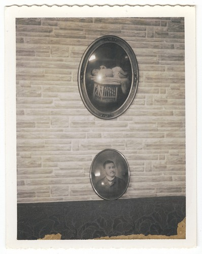 Image for Photographic print of two framed portraits hanging on a wall