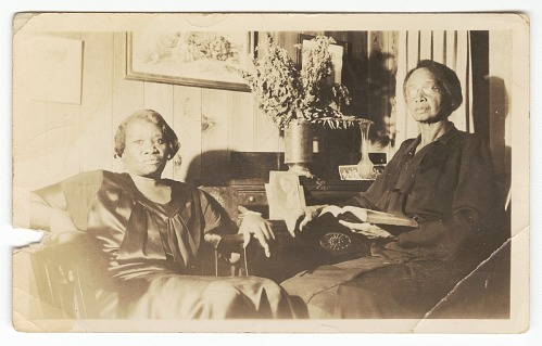 Image for Photographic print of two women sitting inside a house