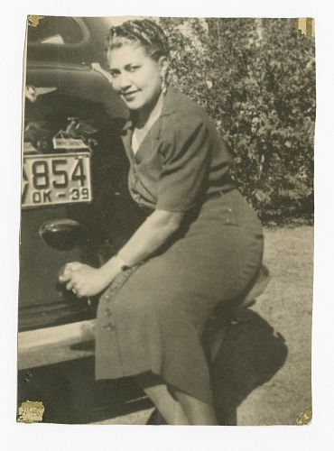 Image for Photographic print of a woman sitting on rear bumper of a car