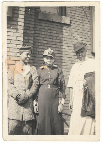 Image for Photographic print of three women standing in front of a brick building