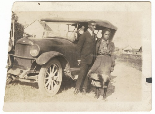 Image for Photographic print of a man and woman standing in front of a car