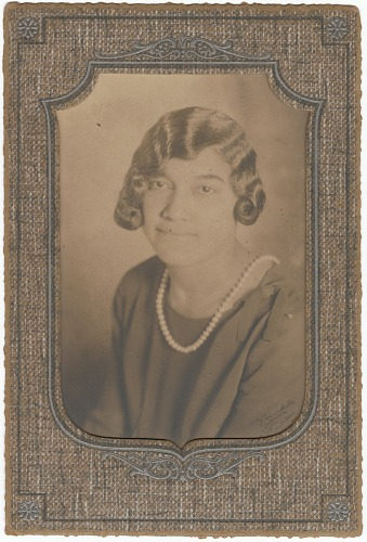 Image for Photographic print of a young Eunice Jackson wearing a pearl necklace