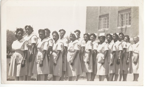 Image for Photographic print of a row of women in nurse's uniforms