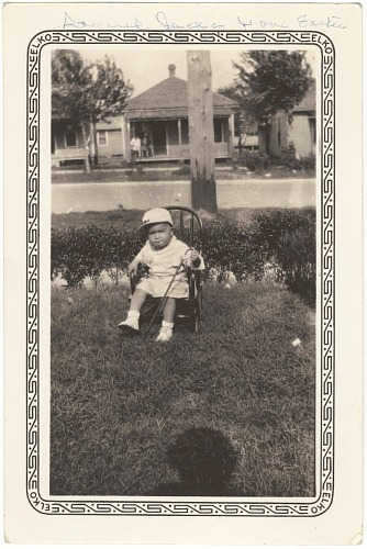 Image for Photographic print of a Samuel M. Jackson, Jr. sitting on a chair in the lawn