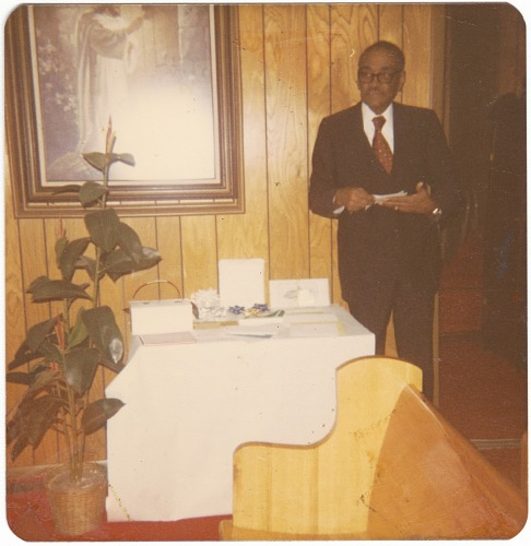 Image for Chromogenic print of a man in a corner behind a church pew