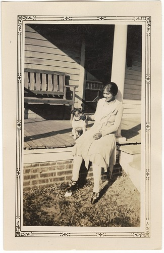 Image for Photographic print of a woman sitting on a porch petting a dog