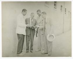 Photograph of four employees outside Atlanta Life