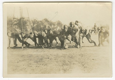 Photograph of men playing football