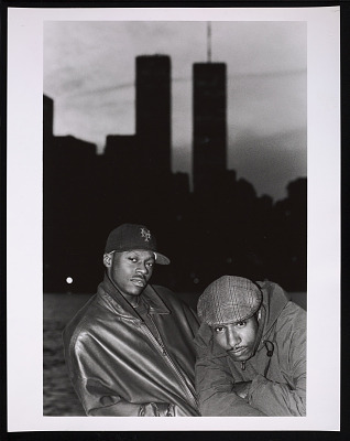 Photograph of Mista Lawnge and Dres of Black Sheep in front of WTC towers