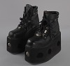 thumbnail for Image 1 - Black platform ankle boots worn by Bootsy Collins