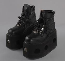 Black platform ankle boots worn by Bootsy Collins