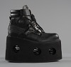 thumbnail for Image 5 - Black platform ankle boots worn by Bootsy Collins