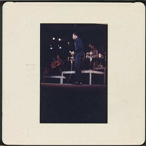 Image for Color slide of Harry Belafonte performing at a fundraiser at Boston Garden