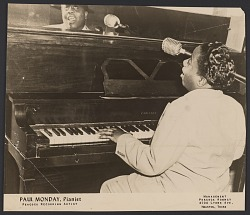 Gelatin silver print of Paul Monday playing the piano