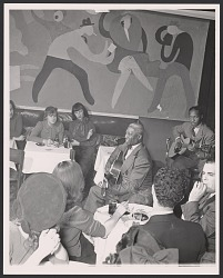 Gelatin silver print of Lead Belly playing the guitar