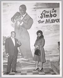 Mr. & Mrs. Louis Armstrong pose in front of his Bop City mural