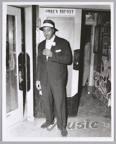 Image for Dapper musician steps out for a smoke, c. mid 1950s