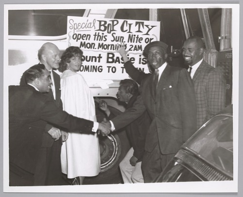 Image for Bop City proprietor, Jimbo (wearing beret) with guests, c. mid 1950s