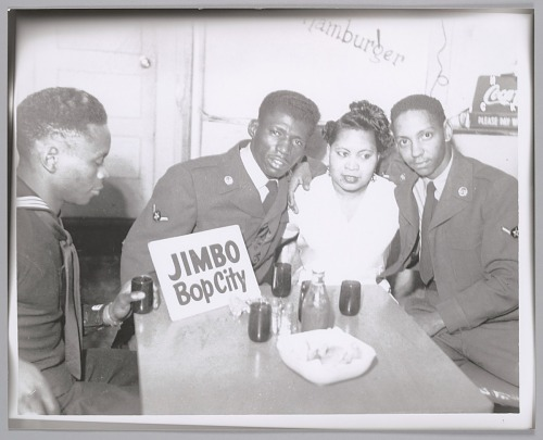 Image for Popular Bop City waitress poses with military men, c. 1952