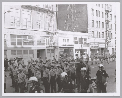 Image for Oakland Police Dept. Tactical Squad & California Hwy. Patrol prepare to engage with antiwar demonstrators at Oakland Draft Induction Ctr., c. 1969