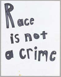 "Poster reading ""Race is not a crime"" used at Baltimore protests"