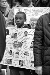 Digital image of a Jaden Powell holding a placard