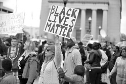 Digital image of a protester holding a Black Lives Matter sign