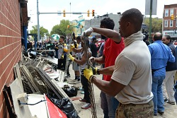 Digital image of Baltimore residents cleaning