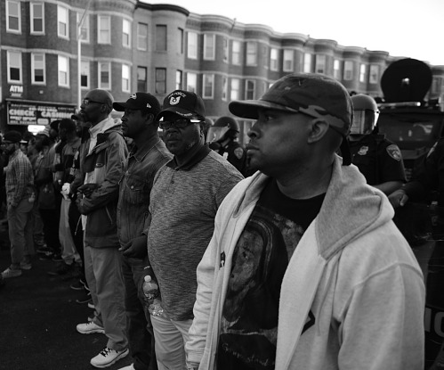 Image for Digital image of protesters linking arms in front of police