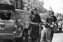 Digital image of a young boy engaging with police officers