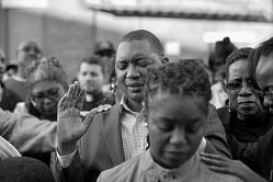 Digital image of protesters praying