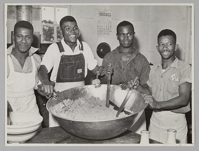 <I>WASECA – BARBADOS ISLAND STORY: IN THE KITCHEN THE COOKS PREPARE MEAT CAKES.</I>