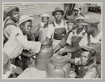 <I>WASECA – BARBADOS ISLAND STORY: FILLING UP COFFEE CUPS AT THE COFFEE URNS AT THE END OF CHOW LINE</I>
