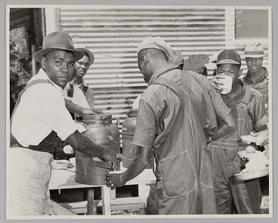 <I>WASECA – BARBADOS ISLAND STORY: FILLING CUPS AT COFFEE URN AT END OF CHOW LINE</I>