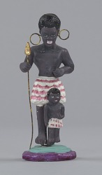 Figurine in the form of a caricatured African woman and child