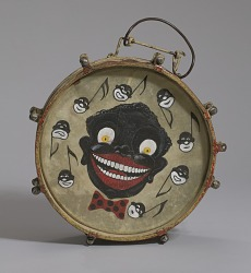 Drum hand-painted depicting caricatures of nine male faces