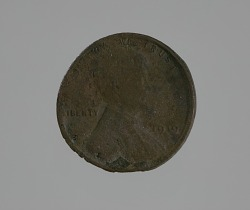 """Riot penny"" charred during the 1921 Tulsa race riot"