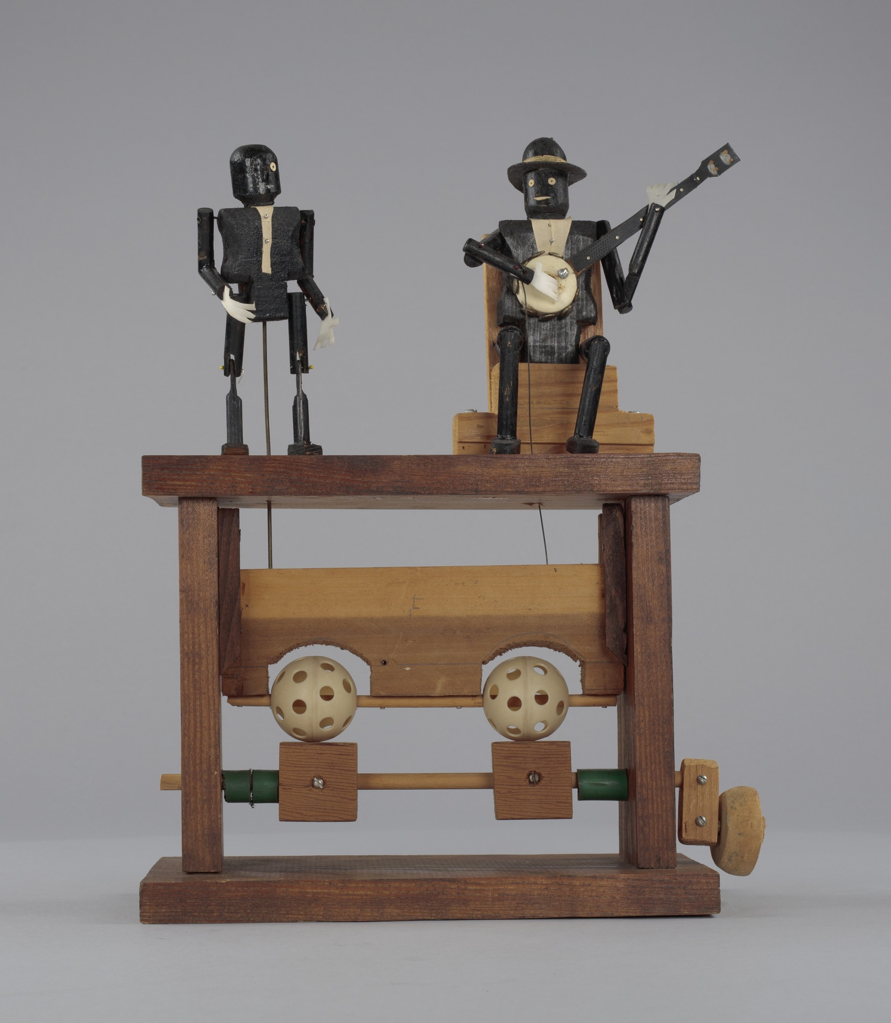 Image 1 for Crank toy in the form of a minstrel banjo player and minstrel male dancer