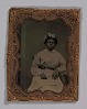 Thumbnail for Tintype of a woman wearing a striped dress with flowers in her hair
