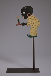 Jointed figure in the form of a caricature of a boy holding a candle