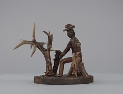 Sculpture in the form of a caricature of a seated hunter