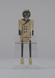 Jig doll in the form of a caricatured porter