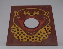 Bean bag toss board depicting a caricature of a clown