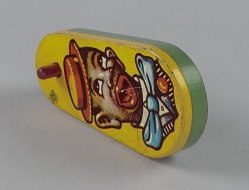 Noisemaker depicting a caricatured man