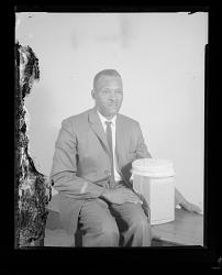 Studio Portrait of a Man Sitting